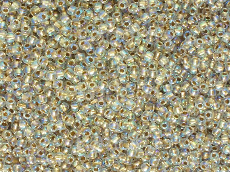 TOHO Round 11o-994 Gold-Lined Rainbow Crystal - 10 g