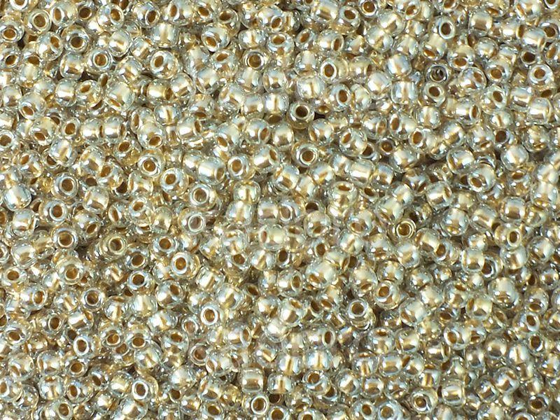TOHO Round 11o-989 Gold-Lined Crystal - 10 g